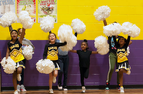 Elementary cheerleaders in gym.