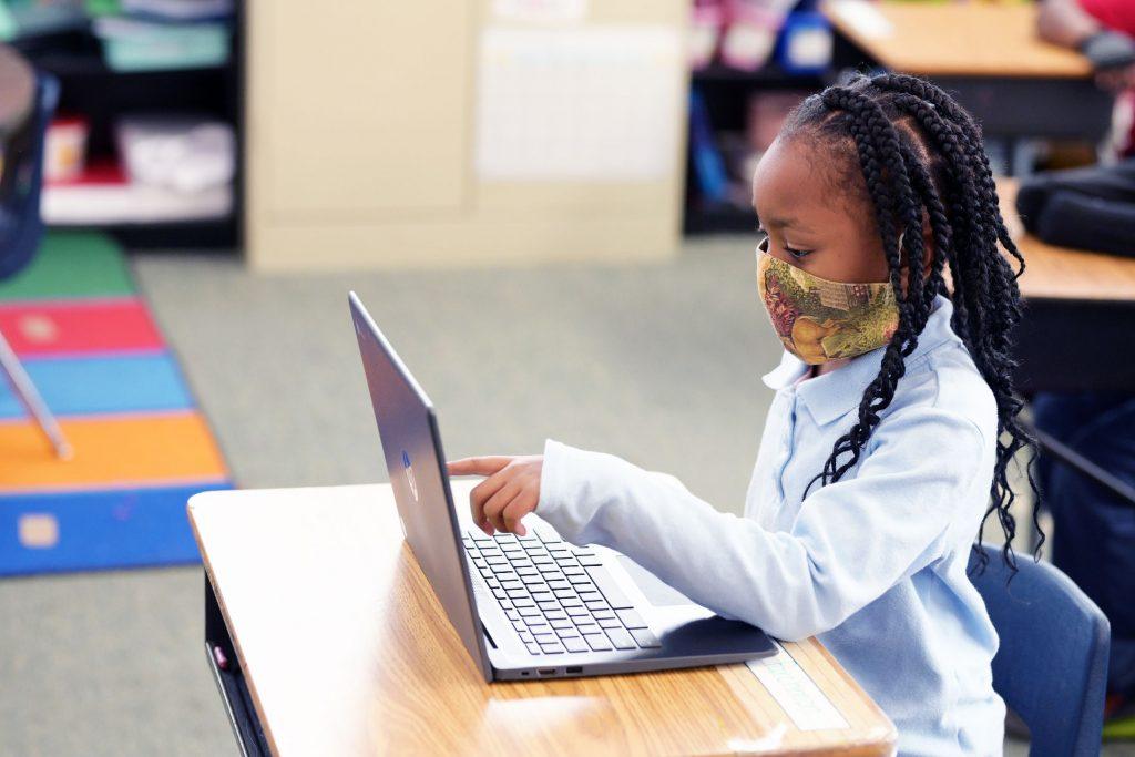 Elementary student using laptop.